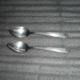 Doua lingurite argintate