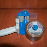 Aplicator de Banda adeziva Lata ( dispenser de banda adeziva ) pentru ambalat .